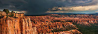 904000028 panoramic view of tourists watching a summer lightning storm pass over the silent city and bryce canyon from bryce point bryce canyon national park utah united states