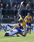 Seadna Morey of Clare  in action against Kevin Moran of Waterford during their National League game at Cusack Park. Photograph by John Kelly.