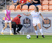 HOUSTON, TX - APRIL 09: Kayla Sharples #28 of the Chicago Red Stars looks to pass the ball during a game between Chicago Red Stars and Houston Dash at BBVA Stadium on April 09, 2021 in Houston, Texas.