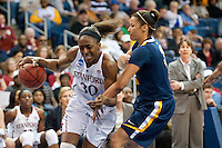 NORFOLK, VA--Nneka Ogwumike drives against the Mountaineer defense during play against West Virginia University at the Ted Constant Convocation Center at Old Dominion University for the second round of the 2012 NCAA Championships. The Cardinal advanced to the West Regionals in Fresno with a score of 72-55.