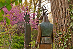 """Sculpture by Liz Wall called """"Standing Watch"""" in the garden of the Manitou Galleries on Canyon Road in Santa Fe, New Mexico"""