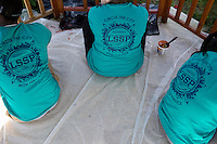 """Member apply wood stain to a gazebo during """"Circle the City with Service,"""" the Kiwanis Circle K International's 2015 Large Scale Service Project, on Wednesday, June 24, 2015, in Indianapolis. (Photo by James Brosher)"""
