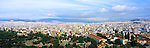 Panoramic view over the rooftops in Athens, Greece<br /> <br /> Image taken on large format panoramic 6cm x 17cm transparency. Available for licencing and printing. email us at contact@widescenes.com for pricing.