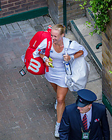 London, England, 4 th. July, 2018, Tennis,  Wimbledon, Womans singles second round, Kiki Bertens (NED) is escorte to the dressing room after her win<br /> Photo: Henk Koster/tennisimages.com