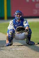 Catcher Phillip Jenkins #19 of the Burlington Royals warms up his pitcher in the bullpen prior to taking on the Greeneville Astros at Burlington Athletic Stadium June22, 2010, in Burlington, North Carolina.  Photo by Brian Westerholt / Four Seam Images