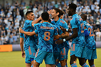 KANSAS CITY, KS - MAY 29: Houston Dynamo players celebrate their opening goal during a game between Houston Dynamo and Sporting Kansas City at Children's Mercy Park on May 29, 2021 in Kansas City, Kansas.