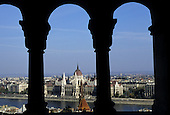 Budapest, Hungary. View through the arches from Buda; the Parliament across the Danube river.