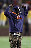 CHARLOTTESVILLE, VA- NOVEMBER 12: Cornerbacks coach Chip West of the Virginia Cavaliers signals to his players during the game against the Duke Blue Devils on November 12, 2011 at Scott Stadium in Charlottesville, Virginia. Virginia defeated Duke 31-21. (Photo by Andrew Shurtleff/Getty Images) *** Local Caption *** Chip West