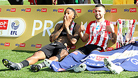 Ivan Toney and Emiliano Marcondes, the Brentford goalscorers, relax with the Championship Trophy after the match during Brentford vs Swansea City, Sky Bet EFL Championship Play-Off Final Football at Wembley Stadium on 29th May 2021