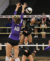 Trinity Hamilton (3) of Bentonville with spike over Sophie Snodgrass (10) of Fayetteville on Thursday, Oct.  7, 2021, during play at Tiger Arena in Bentonville. Visit nwaonline.com/211008Daily/ for today's photo gallery.<br /> (Special to the NWA Democrat-Gazette/David Beach)