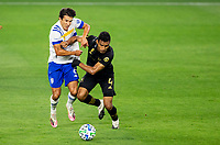 LOS ANGELES, CA - SEPTEMBER 02: Shea Salinas #6 of the San Jose Earthquakes and Eddie Segura #4 of LAFC battle for a ball during a game between San Jose Earthquakes and Los Angeles FC at Banc of California stadium on September 02, 2020 in Los Angeles, California.