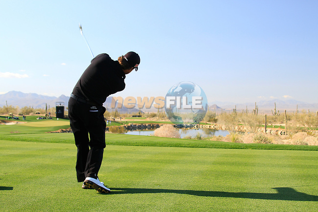 Graeme McDowell tees off on the par 3 3rd tee during Day 2 of the Accenture Match Play Championship from The Ritz-Carlton Golf Club, Dove Mountain. (Photo Eoin Clarke/Golffile 2011)
