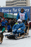 Tim Pappas and team leave the ceremonial start line with an Iditarider and handler at 4th Avenue and D street in downtown Anchorage, Alaska on Saturday March 7th during the 2020 Iditarod race. Photo copyright by Cathy Hart Photography.com