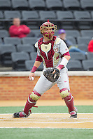 Florida State Seminoles catcher Danny De La Calle (13) checks the runner at first during the game against the Wake Forest Demon Deacons at Wake Forest Baseball Park on April 19, 2014 in Winston-Salem, North Carolina.  The Seminoles defeated the Demon Deacons 4-3 in 13 innings.  (Brian Westerholt/Four Seam Images)