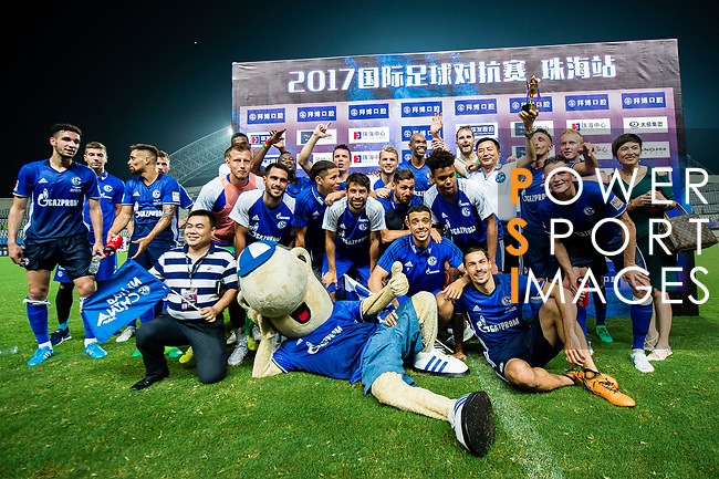 The FC Schalke squad pose for photos with his mascot after winning Besiktas Istambul for the Friendly Football Matches Summer 2017 between FC Schalke 04 Vs Besiktas Istanbul at Zhuhai Sport Center Stadium on July 19, 2017 in Zhuhai, China. Photo by Marcio Rodrigo Machado / Power Sport Images
