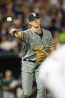 Vanderbilt Commodores pitcher Kyle Wright (44) makes a throw to first base during the NCAA College baseball World Series against the TCU Horned Frogs on June 16, 2015 at TD Ameritrade Park in Omaha, Nebraska. Vanderbilt defeated TCU 1-0. (Andrew Woolley/Four Seam Images)