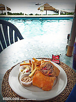 12 July 2013: A Fajita Steak Wrap is presented for lunch on the oceanside deck at Cobalt Coast Resort, in West Bay, Grand Cayman Island. Located in the British West Indies in the  Caribbean, the Cayman Islands are renowned for excellent scuba diving, snorkeling, beaches and banking.  Mandatory Credit: Ed Wolfstein Photo