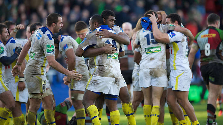 ASM Clermont Auvergne players celebrate at the final whistle during the Heineken Cup Round 5 match between Harlequins and ASM Clermont Auvergne at the Twickenham Stoop on Saturday 11th January 2014 (Photo by Rob Munro)