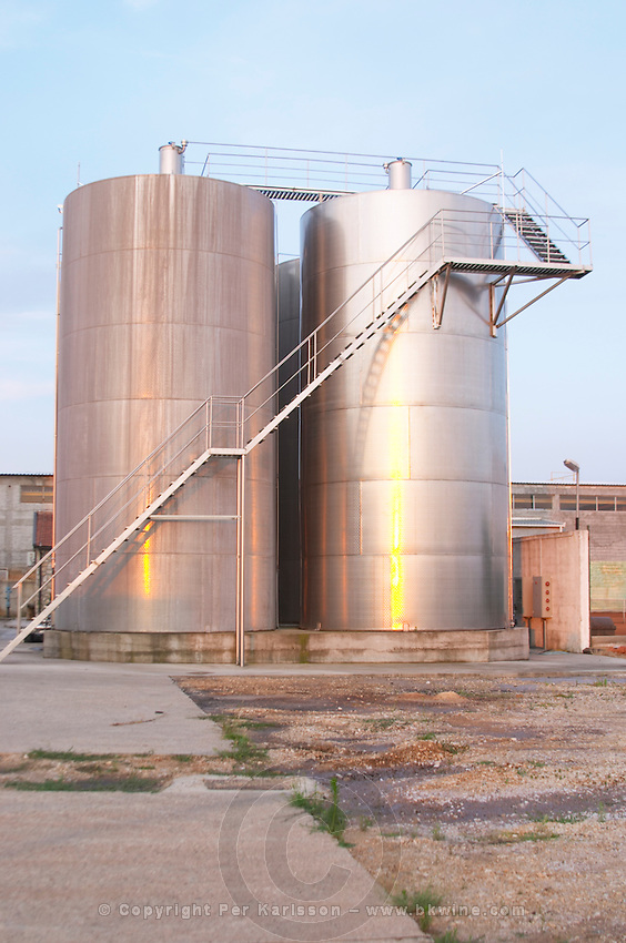 The winery, big stainless steel fermentation tanks outside Hercegovina Produkt winery, Citluk, near Mostar. Federation Bosne i Hercegovine. Bosnia Herzegovina, Europe.