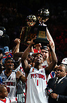 Detroit Pistons' Chauncey Billups hoists the Most Valuable Trophy after his team won the NBA Championship over the Los Angeles Lakers, Tuesday, June 15, 2004, at the Palace in Auburn Hills, Mich.  Detroit defeated Los Angeles, 100-87,  (The Oakland Press/Jose Juarez)