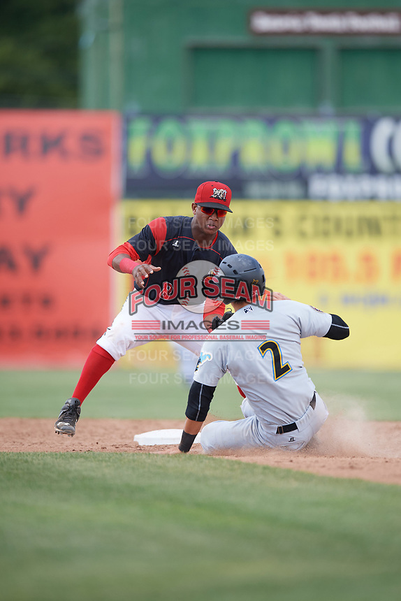 Batavia Muckdogs shortstop Marcos Rivera (8) tags out Tristan Gray (2) attempting to steal second base during a game against the West Virginia Black Bears on June 25, 2017 at Dwyer Stadium in Batavia, New York.  West Virginia defeated Batavia 6-4 in the completion of the game started on June 24th.  (Mike Janes/Four Seam Images)