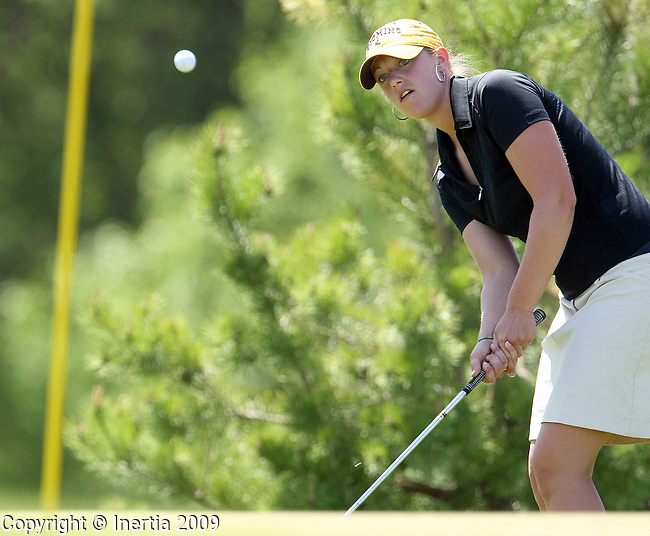 SIOUX FALLS, SD - MAY 19:  Taylor Smalley of Pierre chips on to the 13th green during the final round of the Girls Class AA State Golf Championship Tuesday at the Brandon Golf Course in Brandon. (Photo by Dave Eggen/Inertia).