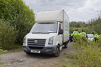 Pictured: The van carrying the sound equipment used, is being driven away by police officers after being confiscated. Monday 31 August 2020<br /> Re: Around 70 South Wales Police officers executed a dispersal order at the site of an illegal rave party, where they confiscated sound gear used by the organisers in woods near the village of Banwen, in south Wales, UK.