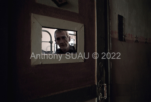 Nizhniy Novogrod, Russia..A TB infected prisoner attempts to speak-out about the poor heating and food conditions in the prison. His name was taken by prison officials immediately after he addressed the photographer.