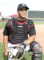 April 20, 2004:  Catcher Miguel Perez of the Dayton Dragons, Midwest League (A) affiliate of the Cincinnati Reds, during a game at Fifth Third Field in Dayton, OH.  Photo by:  Mike Janes/Four Seam Images
