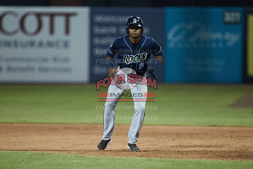 Yasel Antuna (8) of the Wilmington Blue Rocks takes his lead off of first base against the Greensboro Grasshoppers at First National Bank Field on May 25, 2021 in Greensboro, North Carolina. (Brian Westerholt/Four Seam Images)