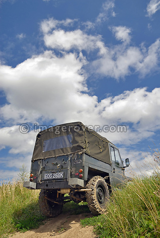 A 1960s Land Rover Lightweight Series 2a driving off road in Bining, France. --- No releases available. Automotive trademarks are the property of the trademark holder, authorization may be needed for some uses.