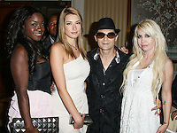 BEVERLY HILLS, CA, USA - MARCH 28: Catherine Annette, Corey Feldman at the Versace Unveiling Of The 1st Pop Recording Artist Superhero - KUBA Ka's Performance Outfits. Designed by the legendary fashion hosuse - Donatella Versace. For the Benefit of the Face Forward Foundation (Plastic Surgery for Destroyed Faces from Violence). Pop entertainer TV personality KUBA Ka, together with VERSACE, unveiled Kuba Ka's new Versace images, for the First Pop Artist/Superhero of the World. He has become the inspiration of Donatella's newest and wildest creations and will celebrate the launch of his new power house conglomerate - KUBA Ka Empire Inc. in collaboration with the sensational fashion house - VERSACE on Friday, his birthday at a red carpet media and celebrity event at the luxurious Peninsula Hotel in Beverly Hills held at the Peninsula Hotel on March 28, 2014 in Beverly Hills, California, United States. (Photo by Xavier Collin/Celebrity Monitor)