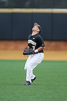 Wake Forest Demon Deacons right fielder Joey Rodriguez (7) settles under a fly ball during the game against the Florida State Seminoles at Wake Forest Baseball Park on April 19, 2014 in Winston-Salem, North Carolina.  The Seminoles defeated the Demon Deacons 4-3 in 13 innings.  (Brian Westerholt/Four Seam Images)
