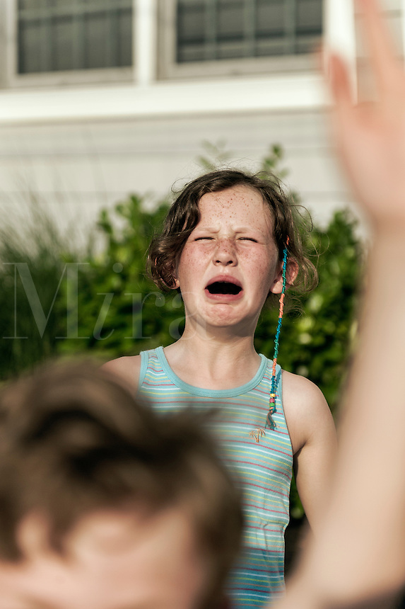 Girl crying after being hit.