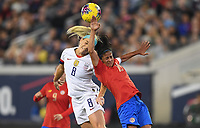 JACKSONVILLE, FL - NOVEMBER 10: Julie Ertz #8 of the United States and Shirley Cruz #10 of Costa Rica battle in the air for a ball during a game between Costa Rica and USWNT at TIAA Bank Field on November 10, 2019 in Jacksonville, Florida.