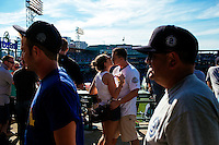 BOSTON, MASS. - SEPT. 28, 2014: Yankee fans Greg Keid (right) and Sara Hotton kiss during the New York Yankees and Boston Red Sox game at Fenway Park. The game is last game of Derek Jeter's career. M. Scott Brauer for The New York Times