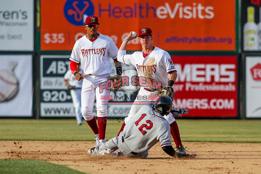 Wisconsin Timber Rattlers second baseman Tucker Neuhaus (19) turns a double play during a Midwest League game against the Quad Cities River Bandits on April 8, 2017 at Fox Cities Stadium in Appleton, Wisconsin.  Wisconsin defeated Quad Cities 3-2. (Brad Krause/Four Seam Images)