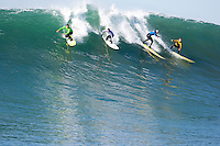 """From left to right, Anthony Tashnick, Evan Slater, Tyler Smith, and Grant """"Twiggy"""" Baker, surf during the semi final heat of the 2008 Mavericks Surf Contest in Half Moon Bay, Calif., Saturday, January 12, 2008."""
