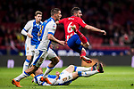 Jorge Resurreccion Merodio, Koke (R), of Atletico de Madrid is tackled by Unai Bustinza, Bustinza M, and Javier Eraso Goni (L) of CD Leganes  during the La Liga 2017-18 match between Atletico de Madrid and CD Leganes at Wanda Metropolitano on February 28 2018 in Madrid, Spain. Photo by Diego Souto / Power Sport Images