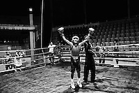After a match, a young boxer celebrates his win. Mohammad Ali Boxing stadium, Dhaka, Bangladesh.