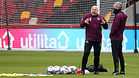 Brentford's Assistant Head Coach, Brian Riemer, chats with Assistant First Team Coach, Kevin O'Connor ahead of kick-off during Brentford vs Barnsley, Sky Bet EFL Championship Football at the Brentford Community Stadium on 14th February 2021