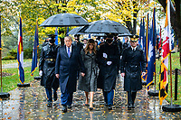 President Donald J. Trump (left), and First Lady Melania Trump (center left), walk with U.S. Army Maj. Gen. Omar Jones IV (right), commanding general, U.S. Army Military District of Washington near the Memorial Amphitheater at Arlington National Cemetery, Arlington, Virginia, November 11, 2020. President Trump laid a wreath just prior to this photo at the Tomb of the Unknown Soldier in observance of Veterans Day. (U.S. Army photo by Elizabeth Fraser / Arlington National Cemetery / released)