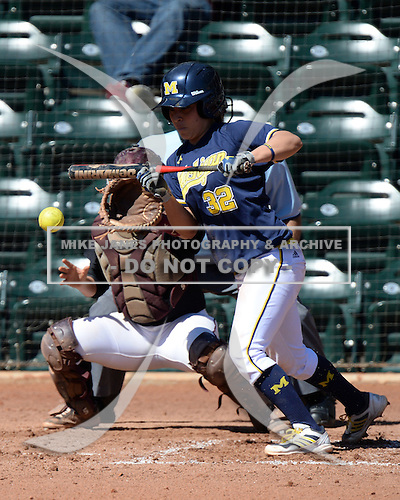 Michigan Wolverines Softball shortstop Sierra Romero (32) lays down a bunt during a game against the Bethune-Cookman on February 9, 2014 at the USF Softball Stadium in Tampa, Florida.  Michigan defeated Bethune-Cookman 12-1.  (Copyright Mike Janes Photography)