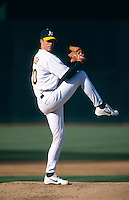 OAKLAND, CA - Mark Mulder of the Oakland Athletics pitches during a game at the Oakland Coliseum in Oakland, California in 2000. Photo by Brad Mangin