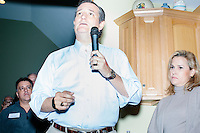 """Texas senator and Republican presidential candidate Ted Cruz speaks to attendees at an event called """"Smoke a cigar with Ted Cruz"""" at a house party at the home of Linda & Steven Goddu Salem, New Hampshire. Cruz's wife, Heidi Nelson Cruz, looks on at right."""