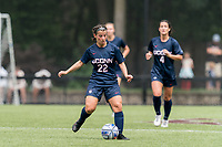 NEWTON, MA - AUGUST 29: Isabelle Lynch #22 of University of Connecticut passes the ball during a game between University of Connecticut and Boston College at Newton Campus Soccer Field on August 29, 2021 in Newton, Massachusetts.