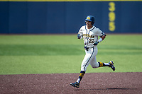 Michigan Wolverines outfielder Tito Flores (22) jogs around the bases after hitting a home run against the Maryland Terrapins on May 23, 2021 in NCAA baseball action at Ray Fisher Stadium in Ann Arbor, Michigan. Maryland beat the Wolverines 7-3. (Andrew Woolley/Four Seam Images)