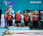 Sochi, RUSSIA - Mar 10 2014 -  Sonja Gaudet, Dennis Thiessen, Ina Forrest and Jim Armstrong prepare to take on Norway in Wheelchair Curling round robin play at the 2014 Paralympic Winter Games in Sochi, Russia.  (Photo: Matthew Murnaghan/Canadian Paralympic Committee)