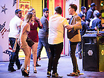 © Joel Goodman - 07973 332324 . 01/01/2016 . Manchester , UK . A man and a woman argue . Revellers in Manchester on a New Year night out at the clubs around the city centre's Printworks venue . Photo credit : Joel Goodman