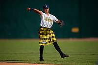 Savannah Bananas Juan Colato (7) warms up before a Coastal Plain League game against the Macon Bacon on July 15, 2020 at Grayson Stadium in Savannah, Georgia.  Savannah wore kilts for their St. Patrick's Day in July promotion.  (Mike Janes/Four Seam Images)